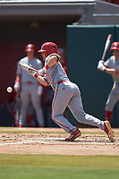 J.T. Jarrett (42) of the North Carolina State Wolfpack lays down a bunt against the Northeastern Huskies at Doak Field at Dail Park on June 2, 2018 in Raleigh, North Carolina. The Wolfpack defeated the Huskies 9-2. (Brian Westerholt/Four Seam Images)