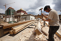 April 29th 2011_Shangri-La, Yunnan, China_ Workers help to refurbish the Songzalin Monastery near the town of Zhongdian (or Shangri-La) in the Tibetan area of northern Yunnan province, China.  Being the largest Tibetan Buddhist monastery in Yunnan, Songzanlin Monastery, also known as Guihua Monastery, is one of the famous monasteries in the Kang region. The monastery is located near Shangri -La County, at the foot of Foping Mountain.  Photographer: Daniel J. Groshong/The Hummingfish Foundation