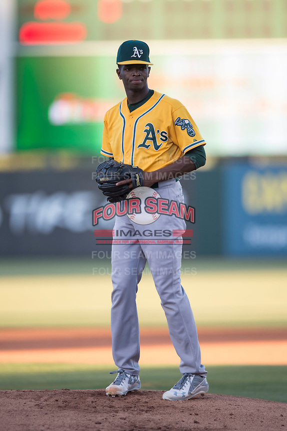 AZL Athletics starting pitcher Ismael Aquino (38) prepares to deliver a pitch during an Arizona League game against the AZL Angels at Tempe Diablo Stadium on June 26, 2018 in Tempe, Arizona. The AZL Athletics defeated the AZL Angels 7-1. (Zachary Lucy/Four Seam Images)