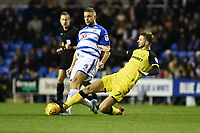 Luke Murphy of Burton Albion is challenged by Joey van den Berg of Reading during the Sky Bet Championship match between Reading and Burton Albion at the Madejski Stadium, Reading, England on 23 December 2017. Photo by Paul Paxford.