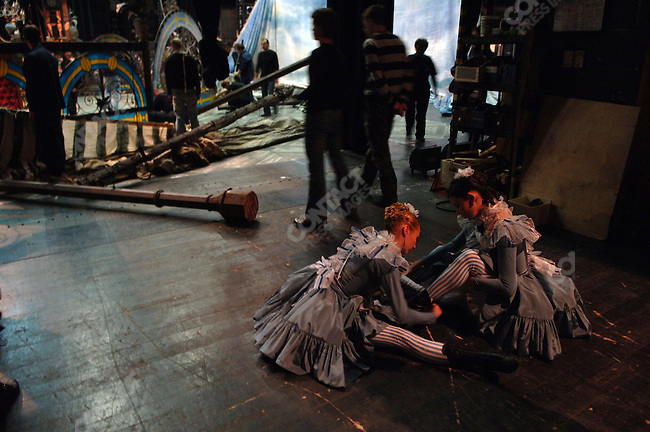 Two dancers of the Bolshoi Ballet did up their boots before a performance of Massine's Gaite Parisienne at the Bolshoi Theatre's New Stage in Moscow, Russia, January 25, 2007