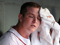 June 19, 2009: Starting pitcher RHP Brock Huntzinger (24) of the Greenville Drive wipes his face with a towel during game against the Lexington Legends at Fluor Field at the West End in Greenville, S.C. Photo by: Tom Priddy/Four Seam Images
