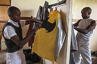 Jockeys Jacob Lokorian,left and Dennis Kiprotich, right, prepare  racing  colors on race day at Ngong Racecourse in Nairobi, Kenya. March 17, 2013 Photo: Brendan Bannon