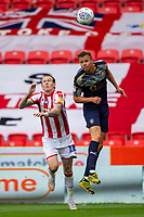 4th July 2020; Bet365 Stadium, Stoke, Staffordshire, England; English Championship Football, Stoke City versus Barnsley; Mads Andersen of Barnsley heads the ball clear