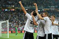 FUSSBALL  EUROPAMEISTERSCHAFT 2012   VORRUNDE Deutschland - Portugal          09.06.2012 Torjubel nach dem 1:0: Mario Gomez, Bastian Schweinsteiger  und Thomas Mueller (v.l., alle Deutschland)