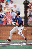 Danville Braves third baseman Brett Langhorne (23) follows through on a swing during a game against the Johnson City Cardinals on July 28, 2018 at TVA Credit Union Ballpark in Johnson City, Tennessee.  Danville defeated Johnson City 7-4.  (Mike Janes/Four Seam Images)