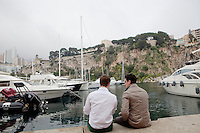 International University of Monaco students Felix (left) and Salvatore (right) spend time on the quayside in the Port of Fontvielle, Fontvielle, Monaco, 19 April 2013. The Prince's Palace of Monaco can be seen at the top of the cliff behind (top centre).