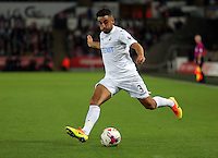 Neil Taylor of Swansea City crosses the ball during the EFL Cup Third Round match between Swansea City and Manchester City at The Liberty Stadium in Swansea, Wales, UK. Wednesday 21 September.