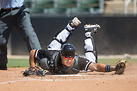 Daniel Gonzalez (8) of the Kannapolis Intimidators makes a diving attempt to tag out a runner at home plate during the game against the Lakewood BlueClaws at Kannapolis Intimidators Stadium on May 8, 2016 in Kannapolis, North Carolina.  The Intimidators defeated the BlueClaws 3-2.  (Brian Westerholt/Four Seam Images)
