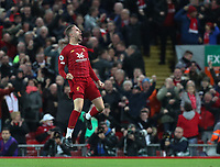 27th October 2019; Anfield, Liverpool, Merseyside, England; English Premier League Football, Liverpool versus Tottenham Hotspur; Jordan Henderson of Liverpool leaps and punches the air after scoring his team's equalising goal after 52 minutes - Strictly Editorial Use Only. No use with unauthorized audio, video, data, fixture lists, club/league logos or 'live' services. Online in-match use limited to 120 images, no video emulation. No use in betting, games or single club/league/player publications