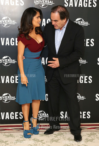 Salma Hayek and Oliver Stone attending the Savages Photocall held at The Mandarin Oriental, London. 19/09/2012 Picture by: Henry Harris / Featureflash