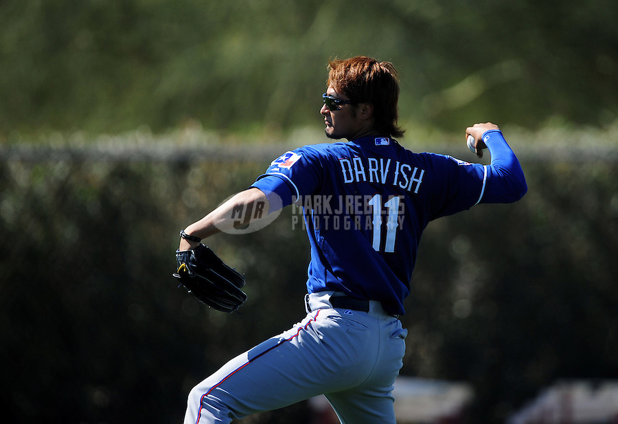 Mar. 1, 2012; Surprise, AZ, USA; Texas Rangers pitcher Yu Darvish during spring training workouts at the practice fields at Surprise Stadium.  Mandatory Credit: Mark J. Rebilas-.