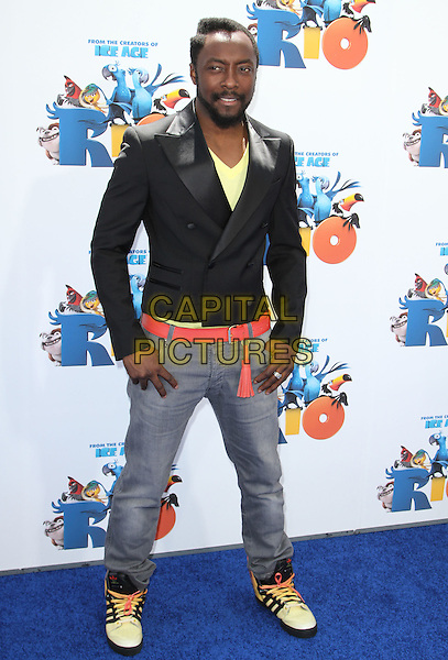 "WILL.I.AM of Black Eyed Peas (William James Adams Jr.).L.A. Premiere of ""RIO"" held at The Grauman's Chinese Theatre in Los Angeles, California, USA,.April 10th 2011.full length black jacket jeans red belt trainers flames wings yellow adidas tassel .CAP/ADM/KB.©Kevan Brooks/AdMedia/Capital Pictures."
