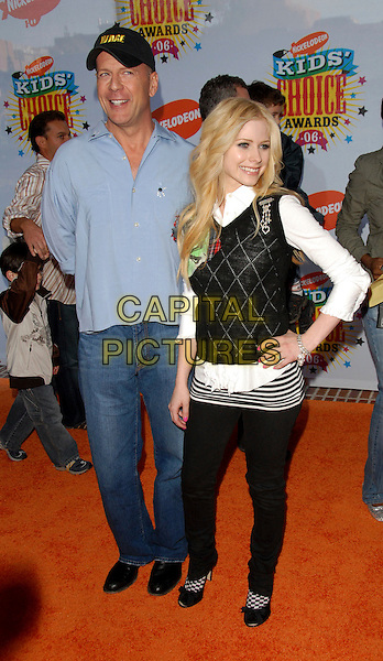 BRUCE WILLIS & AVRIL LAVIGNE.Arrivals at The Nickelodeon's 19th Annual Kids' Choice Awards held at UCLA's Pauley Pavilion in Westwood, California, USA, April 1st 2006..full length blonde hair white shirt black top skinny jeans balck and white socks with shoes hand on hip.Ref: DVS.www.capitalpictures.com.sales@capitalpictures.com.©Debbie VanStory/Capital Pictures