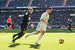 Cristiano Ronaldo of Real Madrid is followed by Ruben Miguel Nunes Vezo of Granada CF during their La Liga match between Real Madrid and Granada CF at the Santiago Bernabeu Stadium on 07 January 2017 in Madrid, Spain. Photo by Diego Gonzalez Souto / Power Sport Images