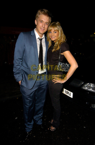 JONATHAN ANSELL & GUEST.The OK! New Year party, Embassy club, London, England..January 15th, 2008.full length blue suit hand on hip black jeans denim top .CAP/CAN.©Can Nguyen/Capital Pictures