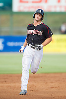 Adam Engel (23) of the Kannapolis Intimidators rounds the bases after hitting a home run against the Asheville Tourists at CMC-NorthEast Stadium on July 13, 2014 in Kannapolis, North Carolina.  The Tourists defeated the Intimidators 8-2.  (Brian Westerholt/Four Seam Images)