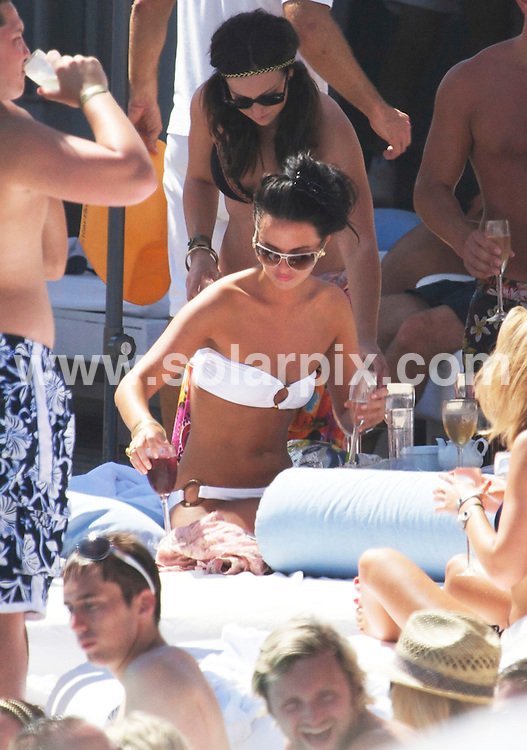 **ALL ROUND EXCLUSIVE PICTURES FROM SOLARPIX.COM**.**WORLDWIDE SYNDICATION RIGHTS**.Hollyoaks McQueen sisters Claire Cooper, who plays Jacqui McQueen, and Jennifer Metcalfe, who plays Mercedes Fisher in the show, plotted up on a large beach bed in the popular Ocean Beach Club in Marbella this weekend. The pair were joined by friends as they relaxed with drinks in the sun, only leaving their bed occasionally  to cool down with a dip in the pool. Marbella, Spain. 30 August 2009.This pic: Jennifer Metcalfe and Claire Cooper..JOB REF: 9827 AB1       DATE: 30_08_2009.**MUST CREDIT SOLARPIX.COM OR DOUBLE FEE WILL BE CHARGED**.**MUST AGREE FEE BEFORE ONLINE USAGE**.**CALL US ON: +34 952 811 768 or LOW RATE FROM UK 0844 617 7637**