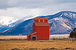 Red barn and mountains in early spring, western Montana