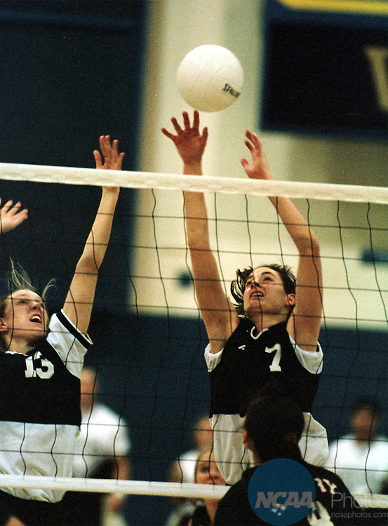 Caption: 7 DEC 1997: West Texas teammates Amanda Sweatt (13) and OH Sarrah Butler (7) reach for the ball during the Division II Women's Volleyball Championship held at Cal State Bakersfield Activities Center on the Cal State Bakersfield campus in Bakersfield, CA. West Texas defeated Barry 3-2 for the championship title. John Lazar/NCAA Photos.