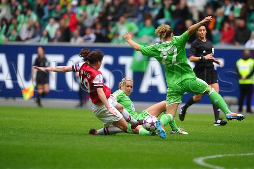 21.04.2013. Wolfsburg, Germany. Womens Champions League, Wolfsburg versus Arsenal, second leg.  l-r:  Niamh FAHEY (FC Arsenal London) , Lena GOESSLING  (VfL Wolfsburg) and Josephine HENNING  (VfL Wolfsburg)