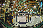 29 December 2013:  Canisius College Golden Griffins forward Jack Hidi, a Freshman from Toronto, Ontario, is checked in the corner near the photo port during the second period against the University of Vermont Catamounts at Gutterson Fieldhouse in Burlington, Vermont. The Catamounts defeated the Golden Griffins 6-2 in the 2013 Sheraton/TD Bank Catamount Cup NCAA Hockey Tournament. Mandatory Credit: Ed Wolfstein Photo *** RAW (NEF) Image File Available ***