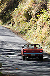 1965 ford   red convertible fall leaves,upstate ny n.y.