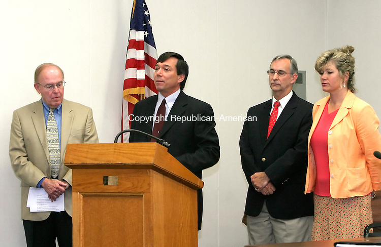 SOUTHBURY, CT--10 JUNE 2007--071007JS05-Southbury First Selectman Mark Cooper, at podium, introduces members of the Southbury Unified Republican Team, from left, John Turk, Jennifer Naylor and Roger Giordano, during a press conference Tuesday at Southbury Town Hall. <br /> Jim Shannon/Republican-American