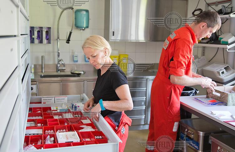 Swiss air ambulance operator Rega. Doctor Marion St&auml;dler and paramedic Gery Bissig prepare medicines.<br /> <br /> <br /> (photo: Fredrik Naumann/Felix Features)