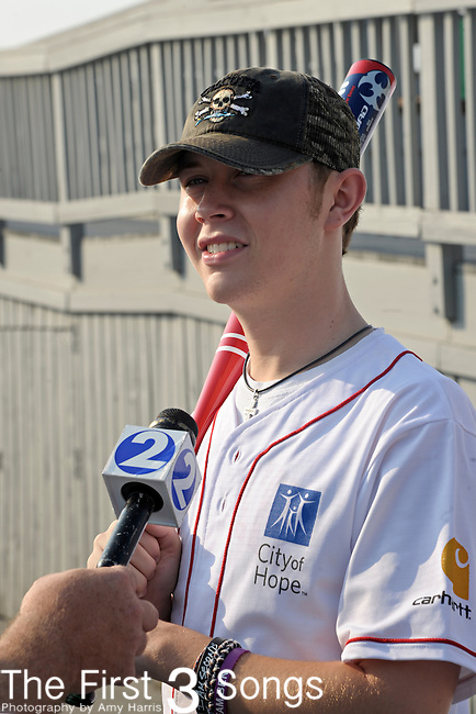 Scotty McCreery attends the 21st annual City of Hope Celebrity Softball Challenge, on Saturday, June 11, at Greer Stadium in Nashville, TN during the 2011 CMA Music Festival.