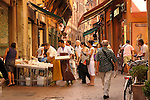 A street full of food vendors in Bologna, Italy.