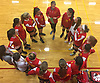 Sacred Heart Academy players listen to Coach Emily Butler, top, between sets in a CHSAA varsity girls volleyball match against host St. John the Baptist High School in West Islip on Thursday, Oct. 12, 2017. Sacred Heart won the match 3-0.