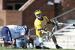 06 February 2016: Michigan's Brad Lott (right) wins a faceoff against North Carolina's Stephen Kelly (left). The University of North Carolina Tar Heels hosted the University of Michigan Wolverines in a 2016 NCAA Division I Men's Lacrosse match. UNC won the game 20-10.