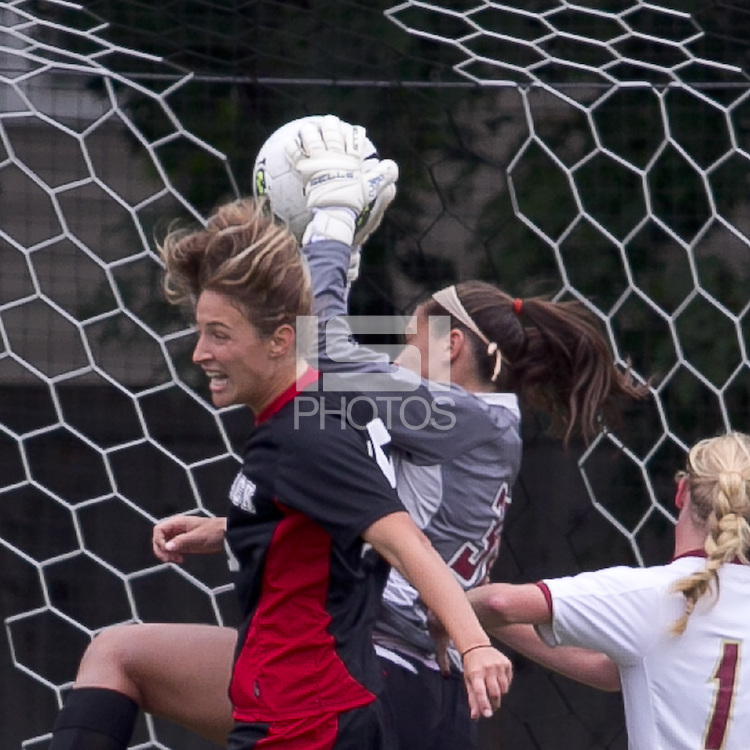 NC State midfielder Kristina Argiroff (15) attempts to head the ball, grabbed by Boston College goalkeeper Jillian Mastroianni (30). Boston College defeated North Carolina State,1-0, on Newton Campus Field, on October 23, 2011.