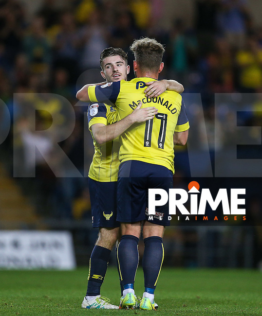 Dan Crowley of Oxford United congratulates Alex MacDonald of Oxford United on his goal during the The Checkatrade Trophy match between Oxford United and Exeter City at the Kassam Stadium, Oxford, England on 30 August 2016. Photo by Andy Rowland / PRiME Media Images.