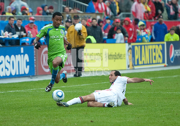 25 April 2010: Seattle Sounders defender James Riley #7 is slide tackled by Toronto FC midfielder Nick LaBrocca #21 during a game between the Seattle Sounders and Toronto FC at BMO Field in Toronto..Toronto FC won 2-0....