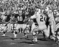 Oakland Raiders Pete Banazak runs after handoff from Daryle Lamonica. Raiders vs Buffalo Bills.<br />