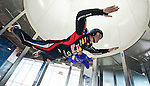 Red Bull Racing driver Mark Webber (front) of Australia practices indoor skydiving in a vertical wind tunnel with top skydiver Jon DeVore of USA during the filming of the second of Infiniti's Inspired Performers' series on June 06, 2012 in Montreal. Photo by Victor Fraile / The Power of Sport Images for Prism/Infiniti