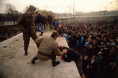 West Berlin, West Germany<br /> November 11, 1989<br /> <br /> East German police mount the wall and push protesters off at the Brandenburg Gate. The East German government lifts travel and emigration restrictions to the West on November 9, 1989.