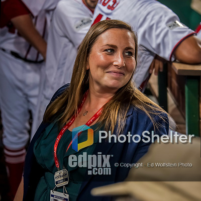 6 October 2017: Washington Nationals Senior Director of Communications Amanda Comak smiles in the dugout prior to the NLDS Game 1 against the Chicago Cubs at Nationals Park in Washington, DC. The Cubs shut out the Nationals 3-0 to take a 1-0 lead in their best of five Postseason series. Mandatory Credit: Ed Wolfstein Photo *** RAW (NEF) Image File Available ***