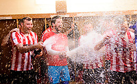 Lincoln City's Matt Rhead, left, and Josh Vickers celebrates in the changing room after winning the league<br /> <br /> Photographer Chris Vaughan/CameraSport<br /> <br /> The EFL Sky Bet League Two - Lincoln City v Tranmere Rovers - Monday 22nd April 2019 - Sincil Bank - Lincoln<br /> <br /> World Copyright © 2019 CameraSport. All rights reserved. 43 Linden Ave. Countesthorpe. Leicester. England. LE8 5PG - Tel: +44 (0) 116 277 4147 - admin@camerasport.com - www.camerasport.com