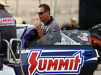 Apr 10, 2015; Las Vegas, NV, USA; NHRA pro stock driver Jason Line licks a lollypop during qualifying for the Summitracing.com Nationals at The Strip at Las Vegas Motor Speedway. Mandatory Credit: Mark J. Rebilas-