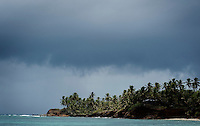 The Caribbean Ocean and palm trees on Little Corn Island, Nicaragua in April, 2009.