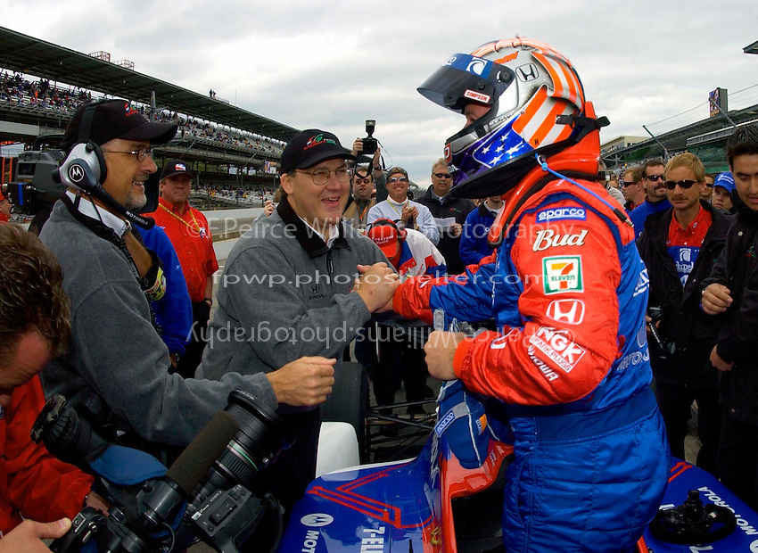 Pole Weekend for the 87th Indianapolis 500, Indianapolis Motor Speedway, Speedway, Indiana, USA  25 May,2003.Robby Gordon receives congratulations from Kim Green (L) and crew after his qualifying run..World Copyright©F.Peirce Williams 2003 .ref: Digital Image Only..F. Peirce Williams .photography.P.O.Box 455 Eaton, OH 45320.p: 317.358.7326  e: fpwp@mac.com..