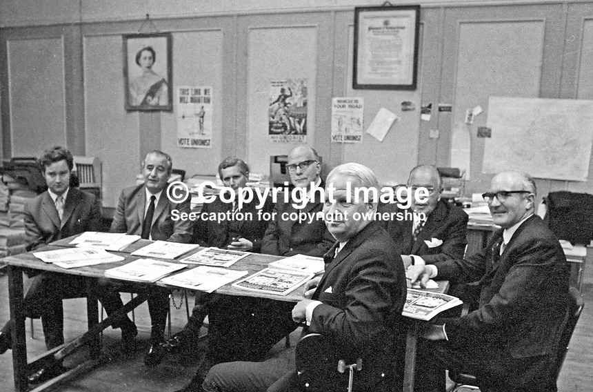 Ulster Unionist Party leader, Brian Faulkner (nearest camera) with his Darlington Conference team at a pre-conference meeting at party HQ in Glengall Street, Belfast, N Ireland. From left: David Smith, Jim Baillie, general secretary, Robert Babington, Albert Anderson, William Fizsimmons and Herbert Kirk. 197209190571.<br /> <br /> Copyright Image from Victor Patterson, 54 Dorchester Park, Belfast, UK, BT9 6RJ<br /> <br /> t1: +44 28 9066 1296 (from Rep of Ireland 048 9066 1296)<br /> t2: +44 28 9002 2446 (from Rep of Ireland 048 9002 2446)<br /> m: +44 7802 353836<br /> <br /> e1: victorpatterson@me.com<br /> e2: victorpatterson@gmail.com<br /> <br /> The use of my copyright images is subject to my Terms &amp; Conditions.<br /> <br /> It is IMPORTANT that you familiarise yourself with them. They are available on my website at www.victorpatterson.com.<br /> <br /> None of my copyright images may be used on a website unless they are visibly watermarked, i.e. &copy; Victor Patterson within the body of the visible image. Metadata denoting my copyright must NOT be deleted. <br /> <br /> Web use is extra at currently recommended NUJ rates.