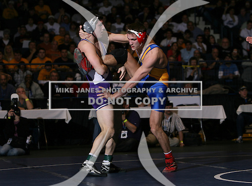 Bryan Bourne (V) and Matt Bogardus (III) square off in the NY State Division One finals at the 160 weight class during the NY State Wrestling Championship finals at Blue Cross Arena on March 9, 2009 in Rochester, New York.  (Copyright Mike Janes Photography)