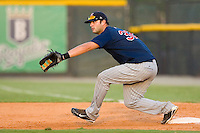 First baseman Michael Gonzales #32 of the Elizabethton Twins stretches for a throw at Burlington Athletic Park July 19, 2009 in Burlington, North Carolina. (Photo by Brian Westerholt / Four Seam Images)