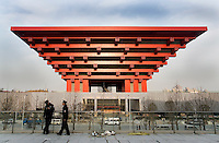 Policemen by the Chinese Pavilion under construction, on Shanghai World Expo site, in Shanghai, China, on March 12, 2010. Photo by Lucas Schifres