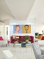 The luxurious penthouse apartment is full of edgy chic and sizzling colour. In the living room a pair of silk-screened prints by Andy Warhol hang above a 1960s Edward Wormley sofa upholstered in a Scalamandré velvet. The chairs in the foreground are by Charles Ramos, and the side table is by Achille Salvagni; the Louis XVI stools, circa 1780, are from Bernd Goeckler Antiques.