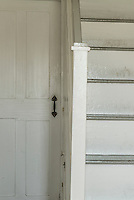 Door and stair detail in old rural home.